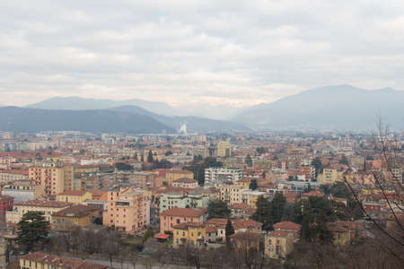 The view of the Brescia cityscape with snow covered mountains on background, Lombardy, Italy. 版權商用圖片