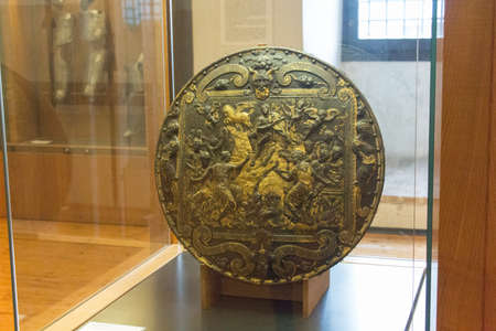 Italy, Brescia -December 31 2017: La rotella da pompa is a circular shields used in the sixteenth century in Luigi Marzoli Arms Museum on December 31 2017, Lombardy, Italy.