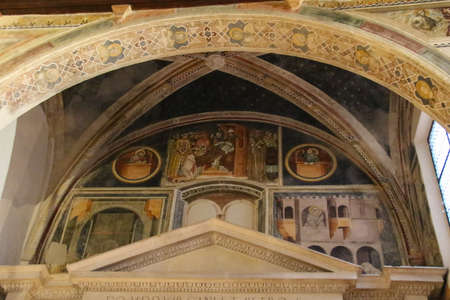 Italy, Verona - December 08 2017: the view of ceiling frescoes in Alighieri Chapel of the upper church San Fermo Maggiore on December 08 2017, Veneto, Italy.