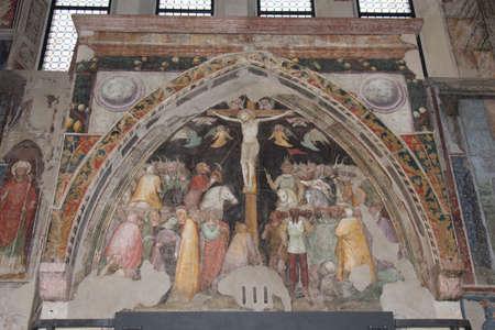 Italy, Verona - December 08 2017: the view of The Crucifix by Turone di Maxio in upper church San Fermo Maggiore on December 08 2017, Veneto, Italy.