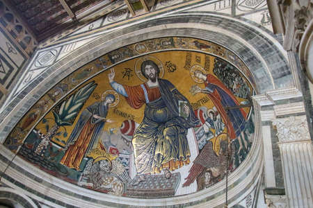 Italy, Florence - April 30 2017: the view of medieval mosaic of Christ between the Virgin and St Minias in Basilica San Miniato al Monte on April 30 2017, Tuscany, Italy.
