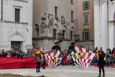 Italy, Brescia - October 01 2017: the view of the flag-bearers performance at traditional festivities of Caterina Cornaro is coming to Brescia on October 01 2017, Lombardy, Italy.