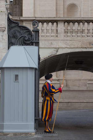Italy, Vatican city - April 18 2017: the view of a guard on sentry duty outside Saint Peter's Basilica on April 18 2017, Vatican city state, Italy. Editorial