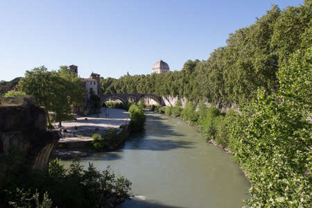 Italy, Rome - April 17 2017: the view of Tiber river and Tiber island seeing from Palatine bridge on April 17 2017, Lazio, Italy.