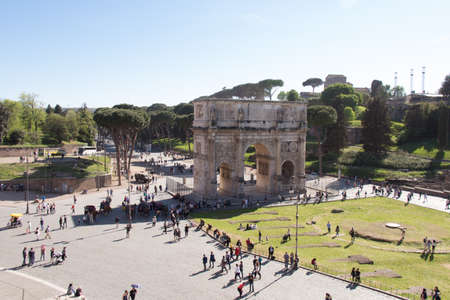 Italy, Rome - April 17 2017: the view of Arch of Constantine next to Coliseum on April 17 2017, Lazio, Italy.