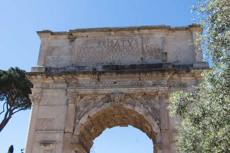 Italy, Rome - April 17 2017: the detailed view of The Triumphal Arch of Titus, Roman Forum on April 17 2017, Lazio, Italy.