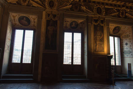 Italy, Florence - May 18 2017: the view of windows in the Room of Leo X in medieval Palazzo Vecchio on May 18 2017 in Florence, Italy.