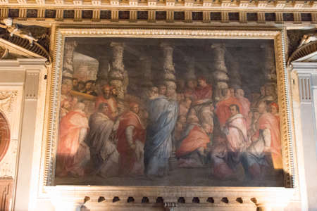 Italy, Florence - May 18 2017: the view of wall painting Leo X elects his new college of cardinals, Room of Leo X in medieval Palazzo Vecchio on May 18 2017 in Florence, Italy. Editorial