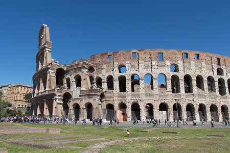 Italy, Rome - April 17 2017: the detailed view of Colosseum with blue sky on background on April 17 2017, Lazio, Italy. 에디토리얼