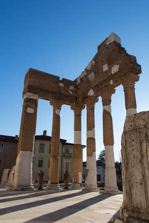 Italy, Brescia - December 24 2017: the view of the ancient Roman temple ruins of Capitolium in Brescia, UNESCO World Heritage Site on December 24 2017, Lombardy, Italy. 写真素材 - 133709446