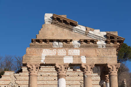 Italy, Brescia - December 24 2017: the view of the ancient Roman temple ruins of Capitolium in Brescia, UNESCO World Heritage Site on December 24 2017 in Brescia, Lombardy, Italy. 写真素材 - 133709456