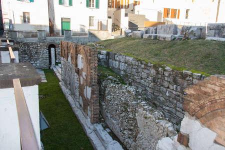Italy, Brescia - December 24 2017: the view ruins of Foro Romano of Capitolium, Ancient Roman temple, UNESCO World Heritage Site on December 24 2017 in Brescia, Lombardy, Italy. 写真素材 - 133709458