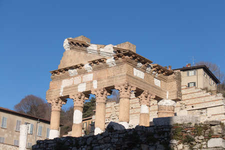 Italy, Lombardy - December 24 2017: the view of the ancient Roman temple ruins of Capitolium in Brescia, UNESCO World Heritage Site on December 24 2017 in Brescia, Lombardy, Italy. 写真素材 - 133709460
