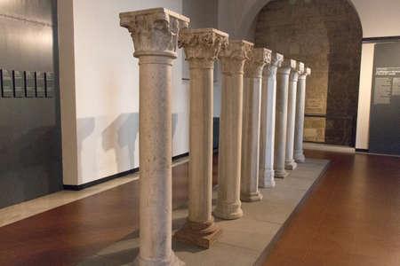 Italy, Brescia - December 24 2017: the view of Pillars representing architecture and decoration XI - XV centuries in Santa Giulia museum on December 24 2017 in Brescia, Lombardy, Italy. 写真素材 - 133709479