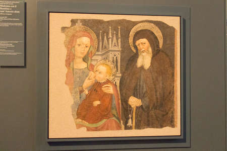 Italy, Lombardy - December 24 2017: the view of wall paintings detachment, Madonna and Child and Sant'Antonio Abate, XV century in Santa Giulia museum on December 24 2017 in Brescia, Lombardy, Italy. 写真素材 - 133709485