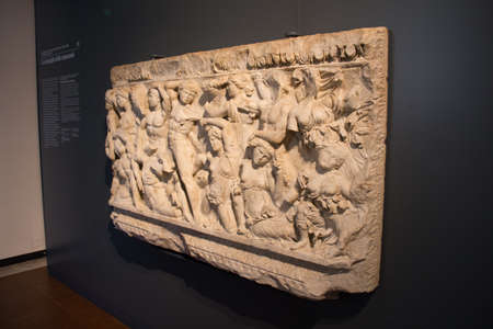 Italy, Lombardy - December 24 2017: the view of the front side of attic sarcophagus 2nd-3d century A.D., The battle of the Amazons, in Santa Giulia museum on December 24 2017 in Brescia, Lombardy, Ita 報道画像