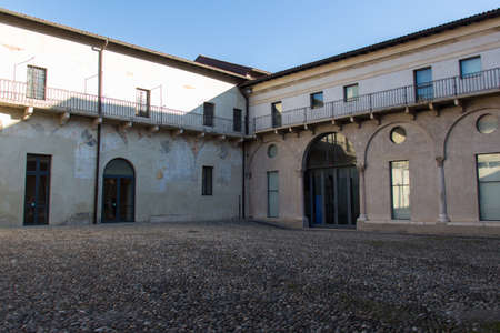 Italy, Brescia - December 24 2017: the view of the inner yard at the entrance of Santa Giulia in Solario Church on December 24 2017 in Brescia, Lombardy, Italy. 写真素材 - 133709493