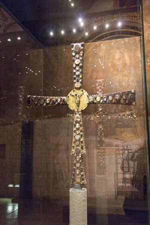 Italy, Brescia - December 24 2017: the back view of the Desiderius Cross, end of 8 century, in the Church Santa Maria in Solario of Santa Giulia museum on December 24 2017 in Brescia, Lombardy, Italy 報道画像
