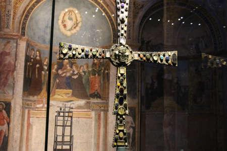 Italy, Brescia - December 24 2017: the front view of the Desiderius' Cross, end of 8 century, in the Church Santa Maria in Solario of Santa Giulia museum on December 24 2017 in Brescia, Lombardy, Italy. 写真素材 - 133709512