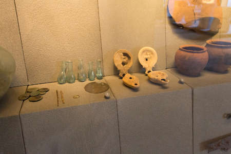 Italy, Brescia - December 24 2017: the view of ancient items of everyday use in the Museum of Santa Giulia on December 24 2017 in Brescia, Lombardy, Italy. 写真素材 - 133709523