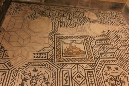 Italy, Brescia - December 24 2017: the view of mosaic floor of the Domus of Dionysus in the Museum of Santa Giulia on December 24 2017 in Brescia, Lombardy, Italy. 写真素材 - 133709534