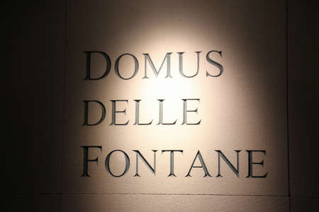 Italy, Brescia - December 24 2017: the view of the lettering on wall in the Museum of Santa Giulia, Domus of the fountains, on December 24 2017 in Brescia, Lombardy, Italy. 写真素材 - 133709539
