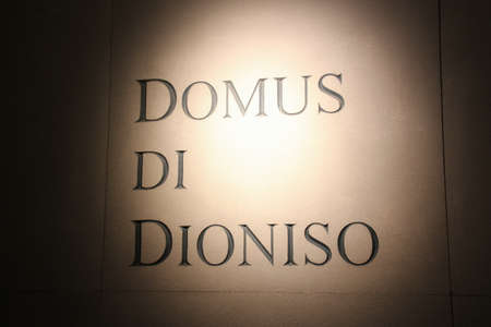 Italy, Brescia - December 24 2017: the view of the lettering on wall in the Museum of Santa Giulia, The Domus of Dionysus, on December 24 2017 in Brescia, Lombardy, Italy. 写真素材 - 133709540
