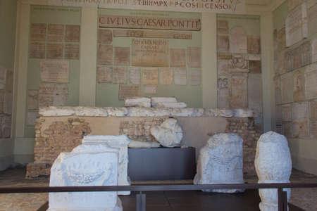 Italy, Brescia - December 24 2017: the view of the lapidarium walls of the Capitolium in Brescia on December 24 2017 in Brescia, Lombardy, Italy. 写真素材 - 133709550