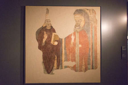 Italy, Brescia - December 24 2017: the view of the fresco, Two beatified Bishops, remounted on canvas from the Broletto, late 13th century, inside the Museum of Santa Giulia on December 24 2017 in Bre