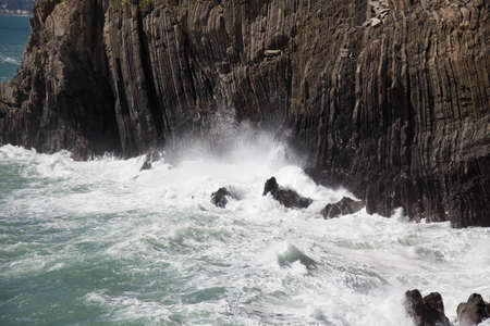 The view of the wave crashes on rocks.