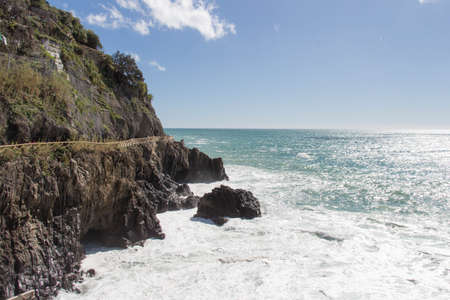 The view of the part of Via dell amore and seascape near Riomaggiore in the National Park of Cinque Terre, Liguria, Italy.
