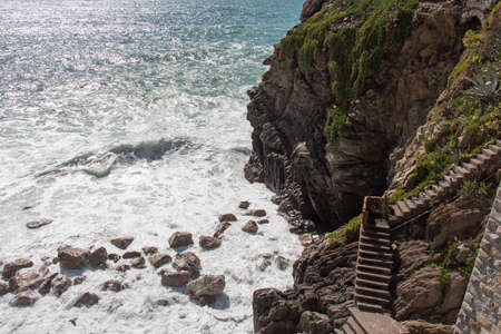 The view of steep stairs and sea near Riomaggiore in the National Park of Cinque Terre, Liguria, Italy.