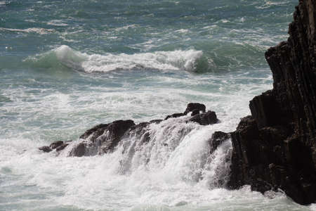 The view of the wave crashing on rocks.