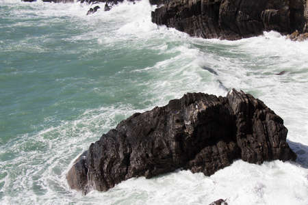 The view of marine landscape with rock and sea waves. 写真素材