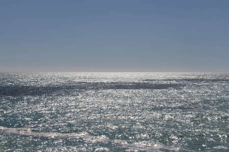 The view of horizon line over sea in a sunny day.