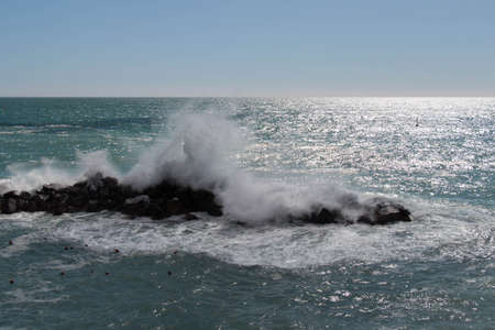 The view of horizon line over sea and a waves are crashing stones. 写真素材