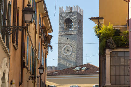 Italy, Brescia - December 24 2017: the back view of the Tower of Pegol, or Tower of the people or Market Tower, on December 24 2017 in Brescia, Lombardy, Italy. 報道画像