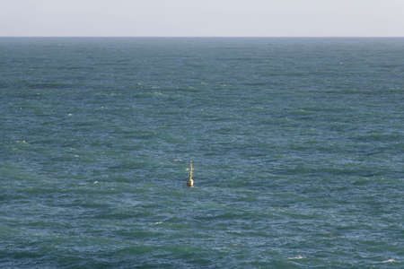 The view of horizon line over sea and buoy.