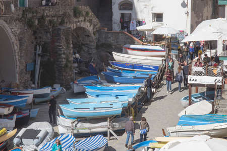 Riomaggiore, Italy - April 1 2018: the view of boats on a street of fisherman village Riomaggiore in the National Park of Cinque Terre on April 1 2018 in Liguria Italy. 報道画像