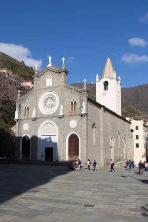Riomaggiore, Italy - April 1 2018: the front view of San Giovanni Battista Church in Riomaggiore, National Park of Cinque Terre on April 1 2018 in Liguria Italy.