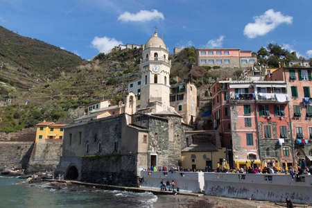 Vernazza, Italy - April 2 2018: the view of the church of Santa Margherita dAntiochia in Vernazza in the National Park of Cinque Terre on April 2 2018 in Liguria Italy. 報道画像