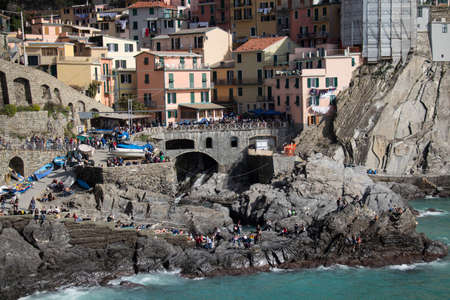 Manarola, Italy - April 2 2018: the view of dock and old houses of small fisherman village Manarola in the National Park of Cinque Terre on April 2 2018 in Liguria Italy.