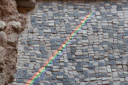 Italy, Brescia - December 24 2017: the view of the rainbow on the floor fragment of Duomus dellOrtaglia in the Museum of Santa Giulia on December 24 2017 in Brescia, Lombardy, Italy. 報道画像