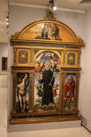 Italy, Brescia - December 24 2017: the view of the tempera and oil on panel, Polyptych of Saint Nicholas of Tolentino, by Vincenzo Civerchio in Brescia Museum on December 24 2017 in Brescia, Lombardy,