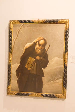 Italy, Brescia - December 24 2017: the view of the oil on canvas, Old man in the snow, by Antonio Cifrondi in Brescia Museum on December 24 2017 in Brescia, Lombardy, Italy.