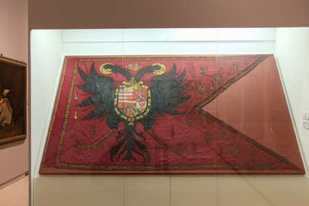 Italy, Brescia - December 24 2017: the view of the oil and sheet on silk damask by Stendardo Caprioli in Brescia Museum on December 24 2017 in Brescia, Lombardy, Italy.