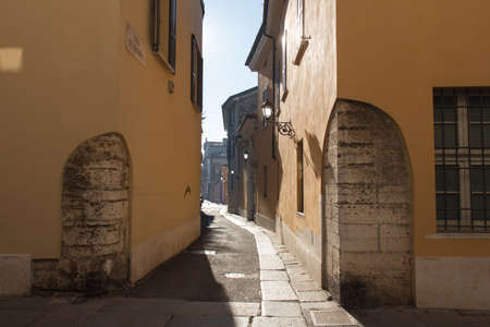 Italy, Lombardy - December 24 2017: the view of the typical street of Brescia in a sunny day on December 24 2017 in Brescia, Lombardy, Italy. 報道画像