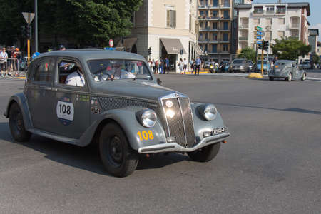 Brescia, Italy - May 19 2018: LANCIA APRILIA 1350 1937 is an old racing car in rally Mille Miglia 2018, live shot at the famous italian historical race on May 19 2018 in Brescia, Italy.