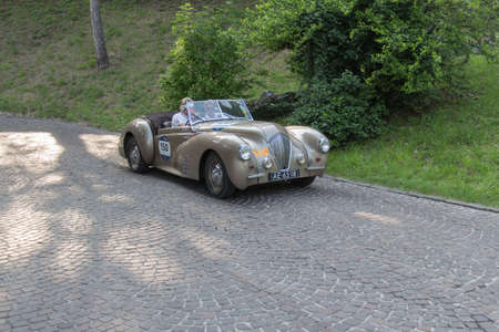 Brescia, Italy - May 19 2018: HEALEY 2400 WESTLAND 1947 is an old racing car in rally Mille Miglia 2018, live shot at the famous italian historical race on May 19 2018 in Brescia, Italy.