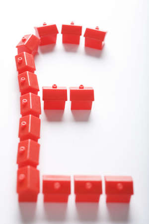 property ladder: Sterling Symbol Formed From Red Model Houses Stock Photo
